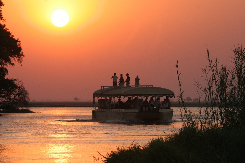 Liquid Giraffe, Under One Botswana Sky, Chobe Safari Lodge, Chobe Bush Lodge, Chobe National Park, Botswana, Safari Package, Safari Experts, Botswana Safari, Water Safari, Boat Safari, Sunset Boat Cruise